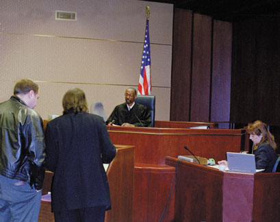 Image individuals giving testimony in court