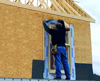Picture of carpenter working on new house