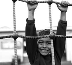 image of of boy swinging on ropes