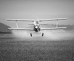 Report cover image of a propeller plane crop dusting a field
